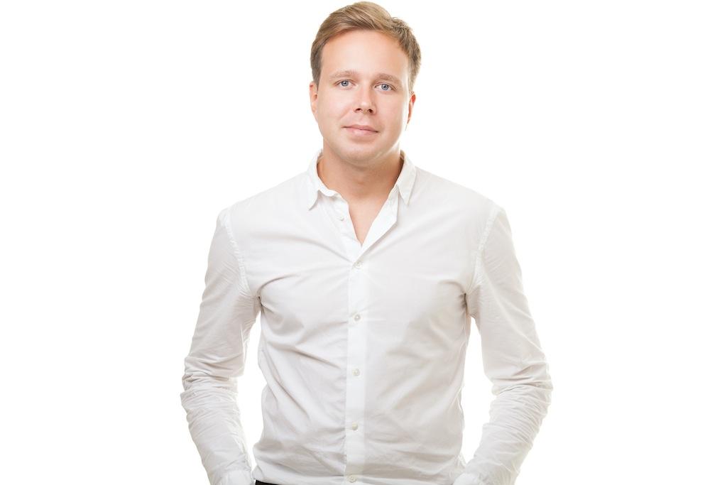 Portrait of confident man posing on white background.