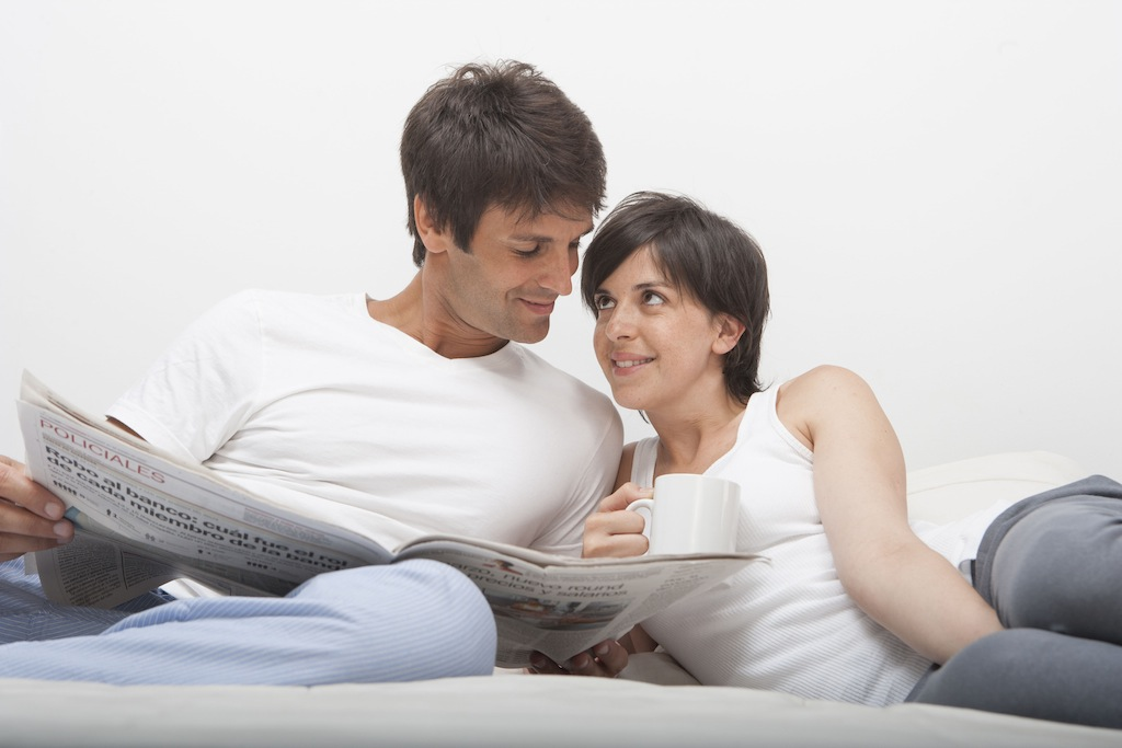 Hispanic couple at home in bed