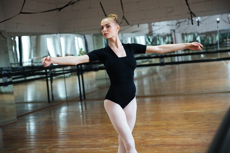 Beautiful woman dancing in ballet class