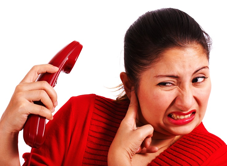 Woman Stressed Listening To A Loud Complaint