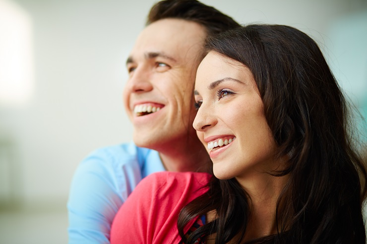 Portrait of amorous smiling young couple