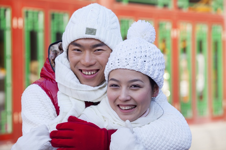 Couple dressed in holiday attire