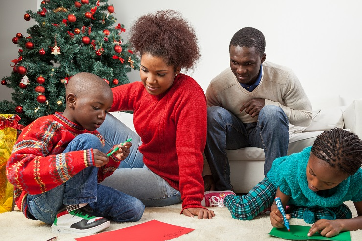Family together writing the letter to santa