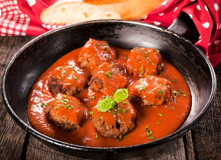 Meat balls and homemade tomatoe sauce in the old pan