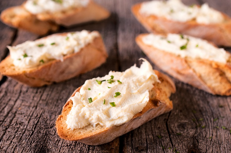 Selective focus in the middle of front bruschetta with cheese cream