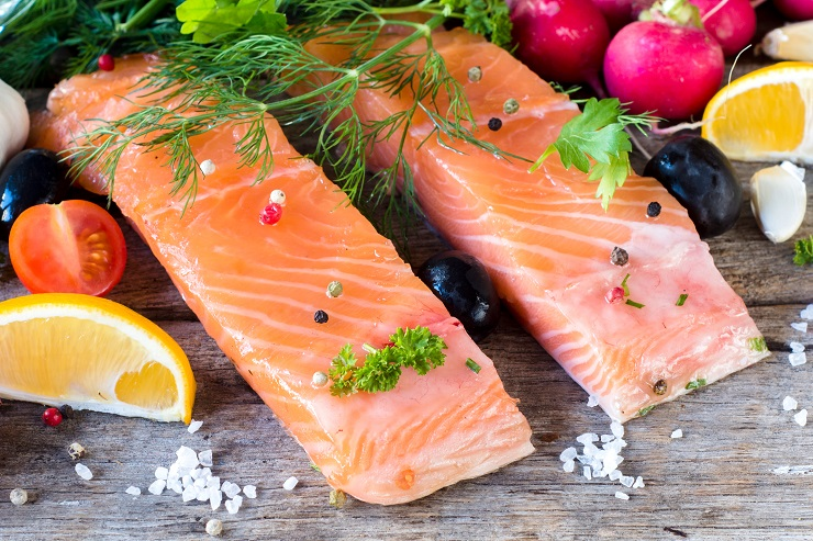 Salmon steak with ingredients on wooden background,selective focus
