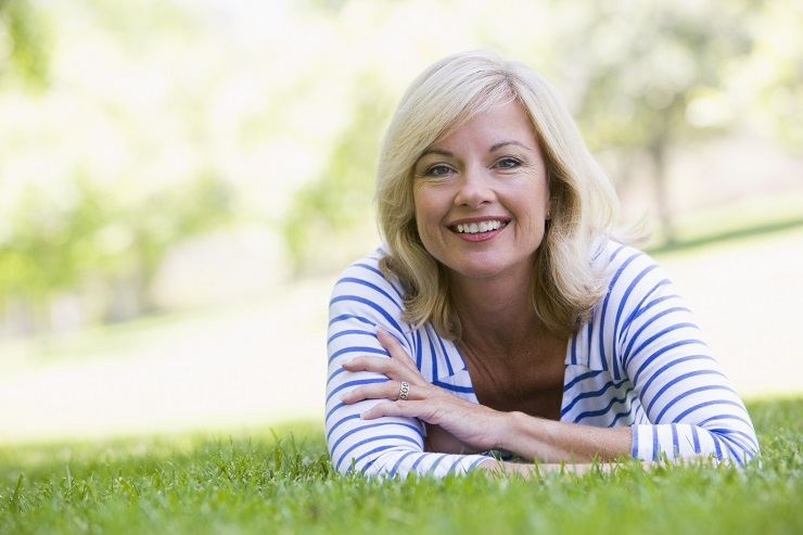 Woman relaxing outdoors smiling