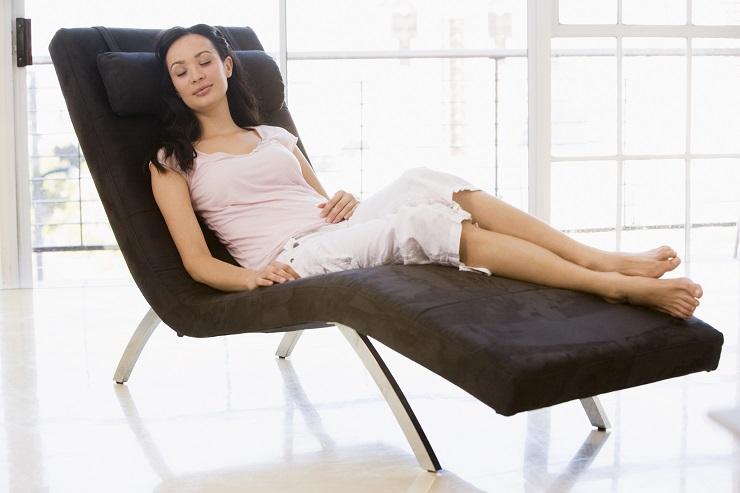Woman sitting in chair sleeping